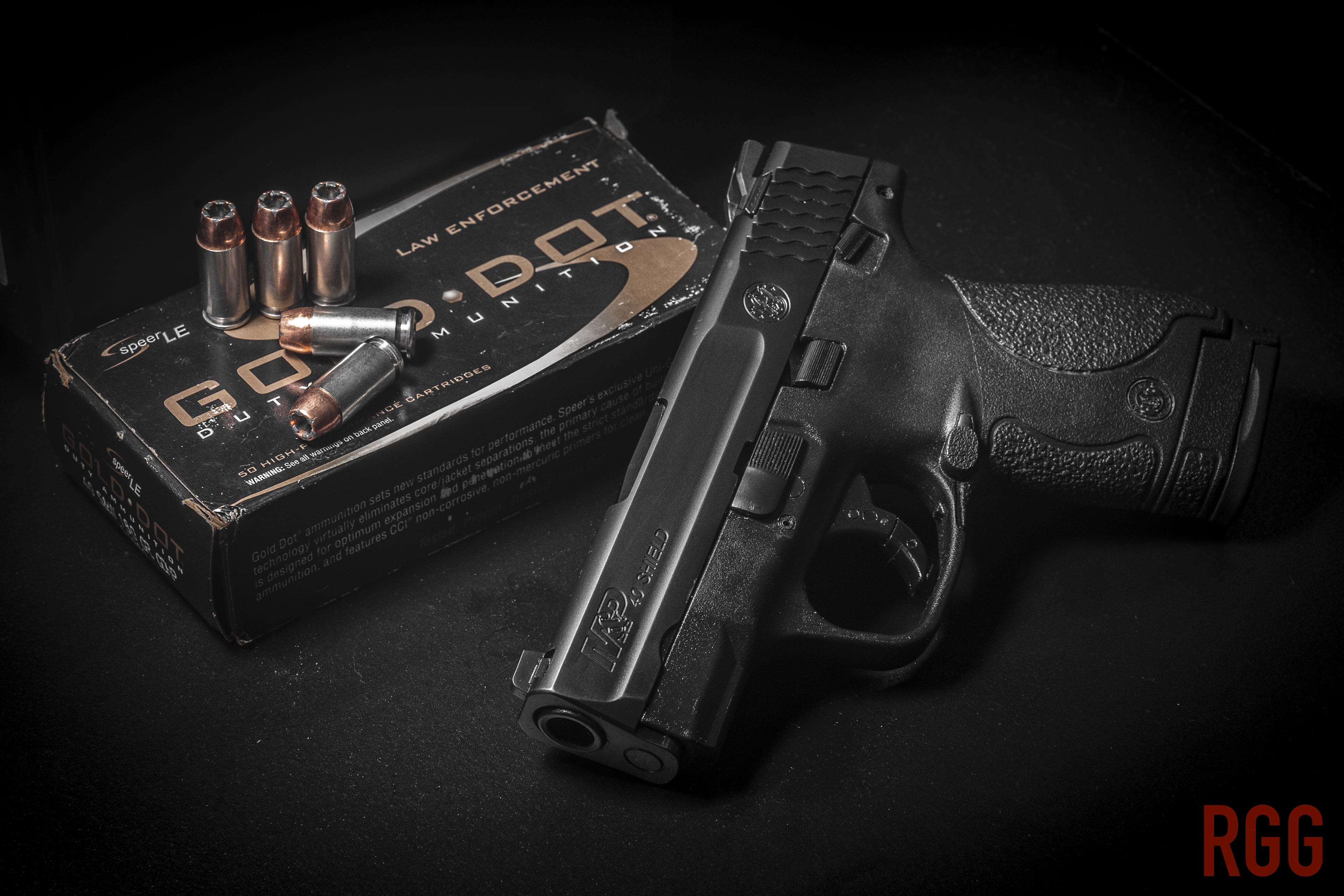A Smith & Wesson M&P 40 Shield Pistol and Speer LE 180 grain Gold Dot Hollow Point .40 S&W ammo.