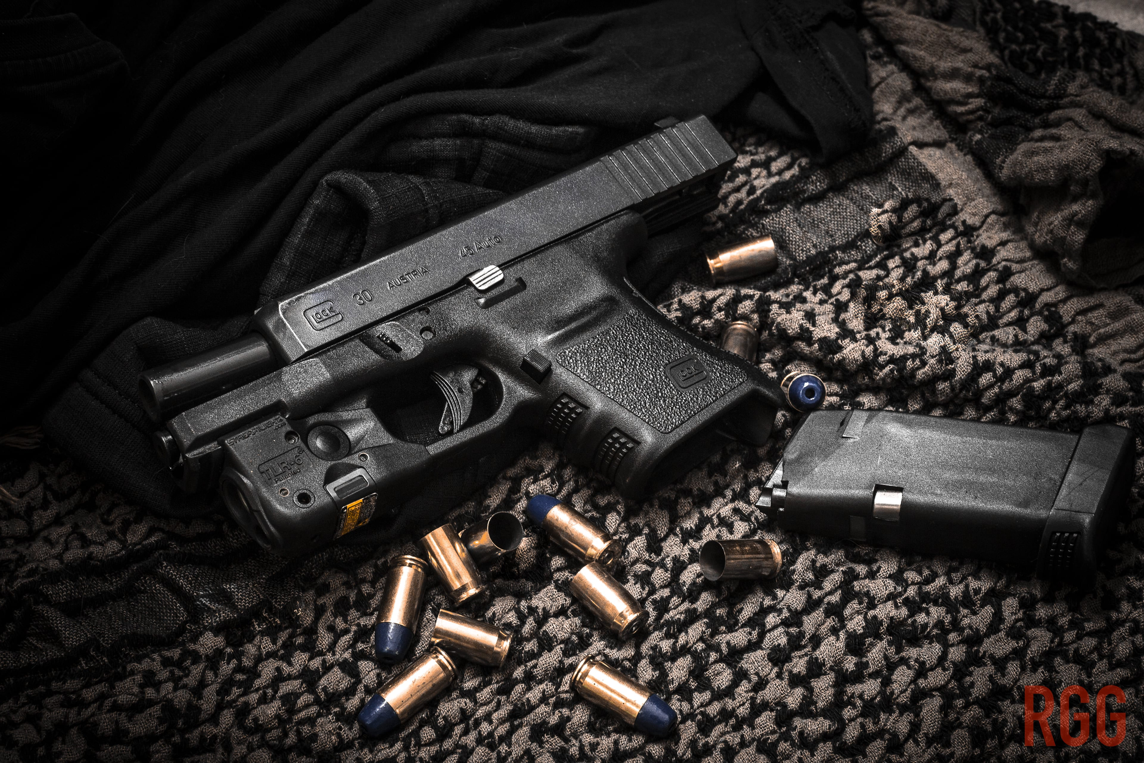 A GLOCK 30 with some spent and unused Federal 45 ACP ammo.