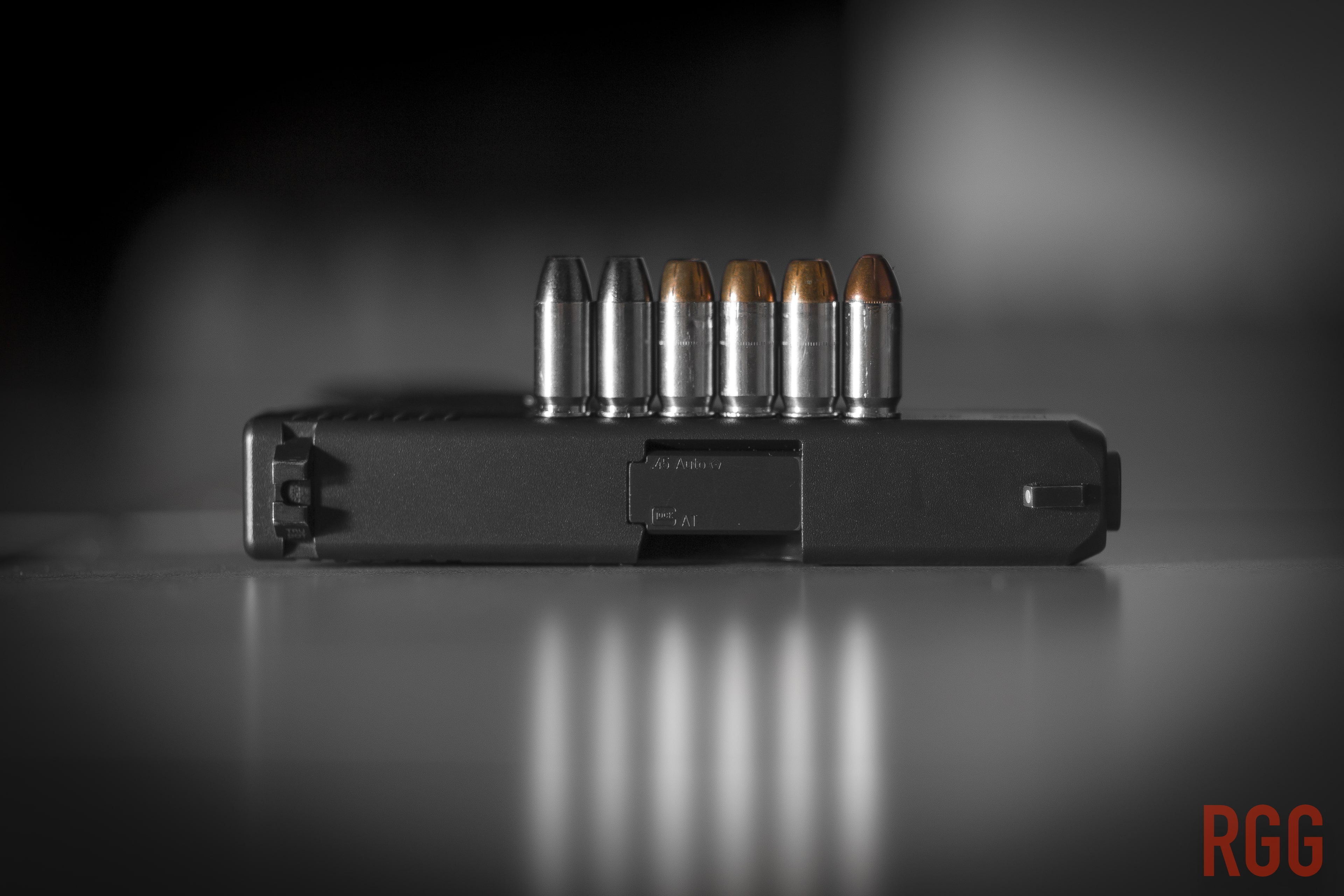 .45 ACP cartridges with a GLOCK 30