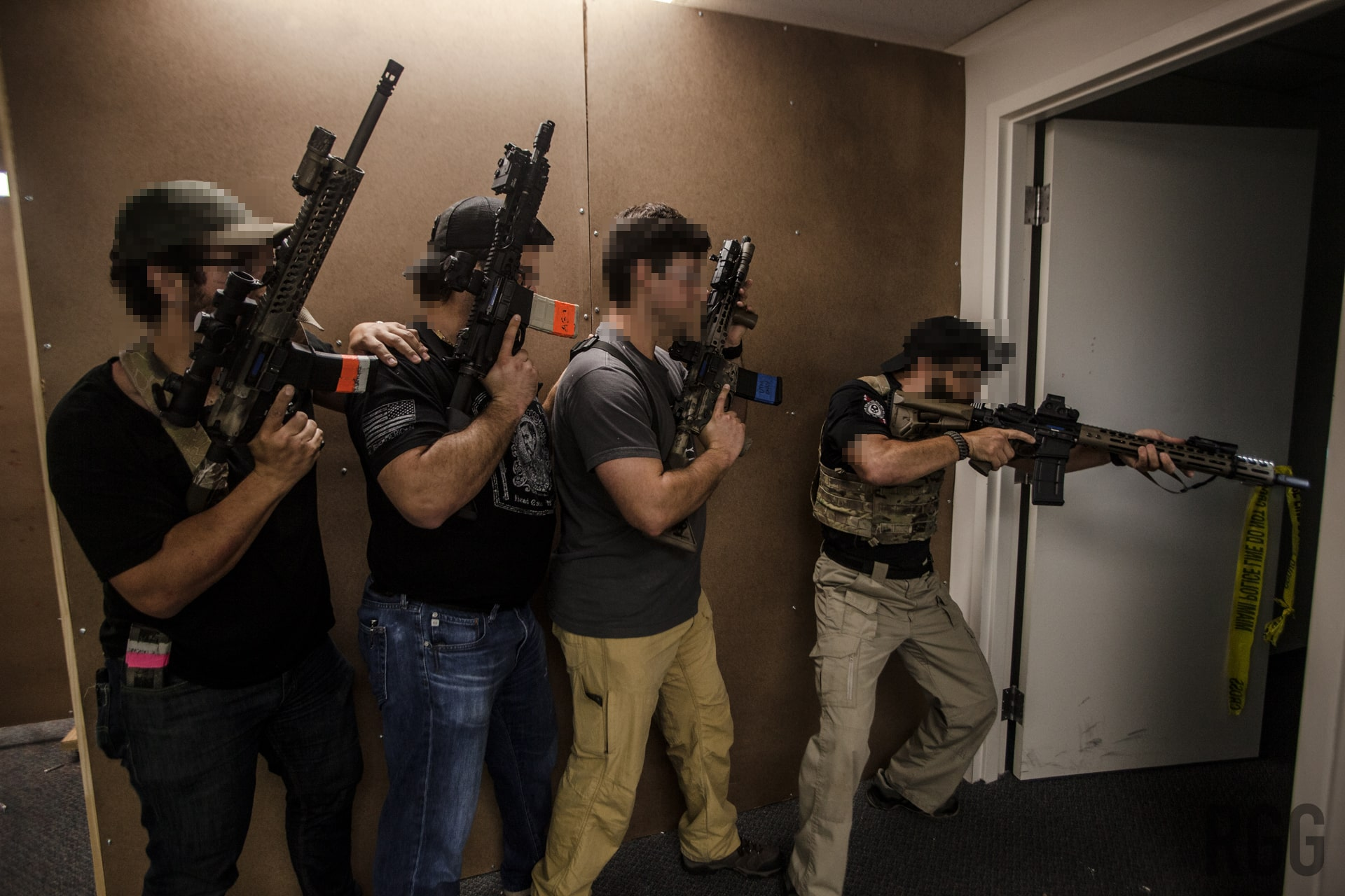 Students learning how to clear a room at DA1 Training in Miami.