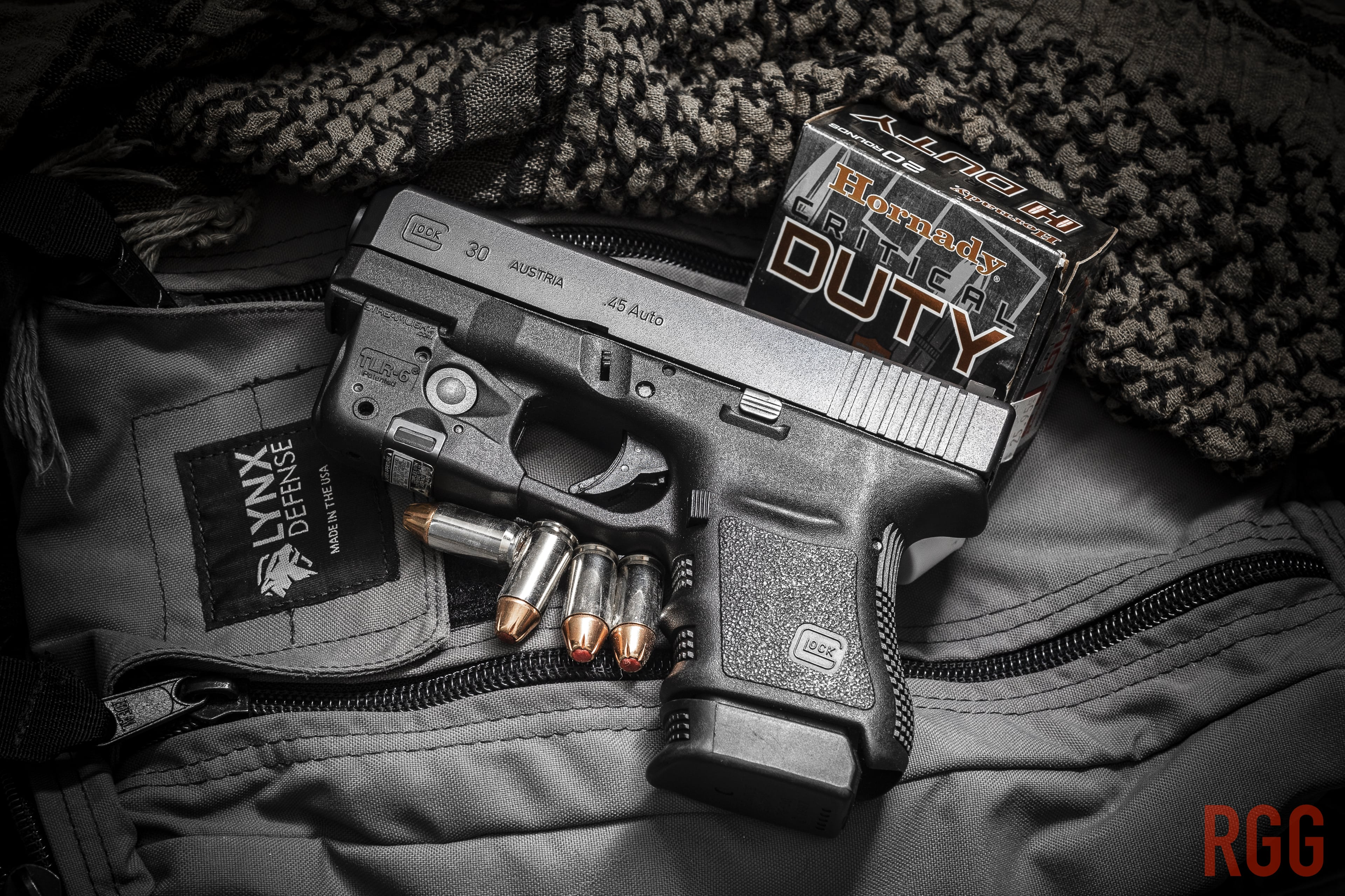 A GLOCK 30 .45 ACP pistol and the Lynx Pistol Range Bag.
