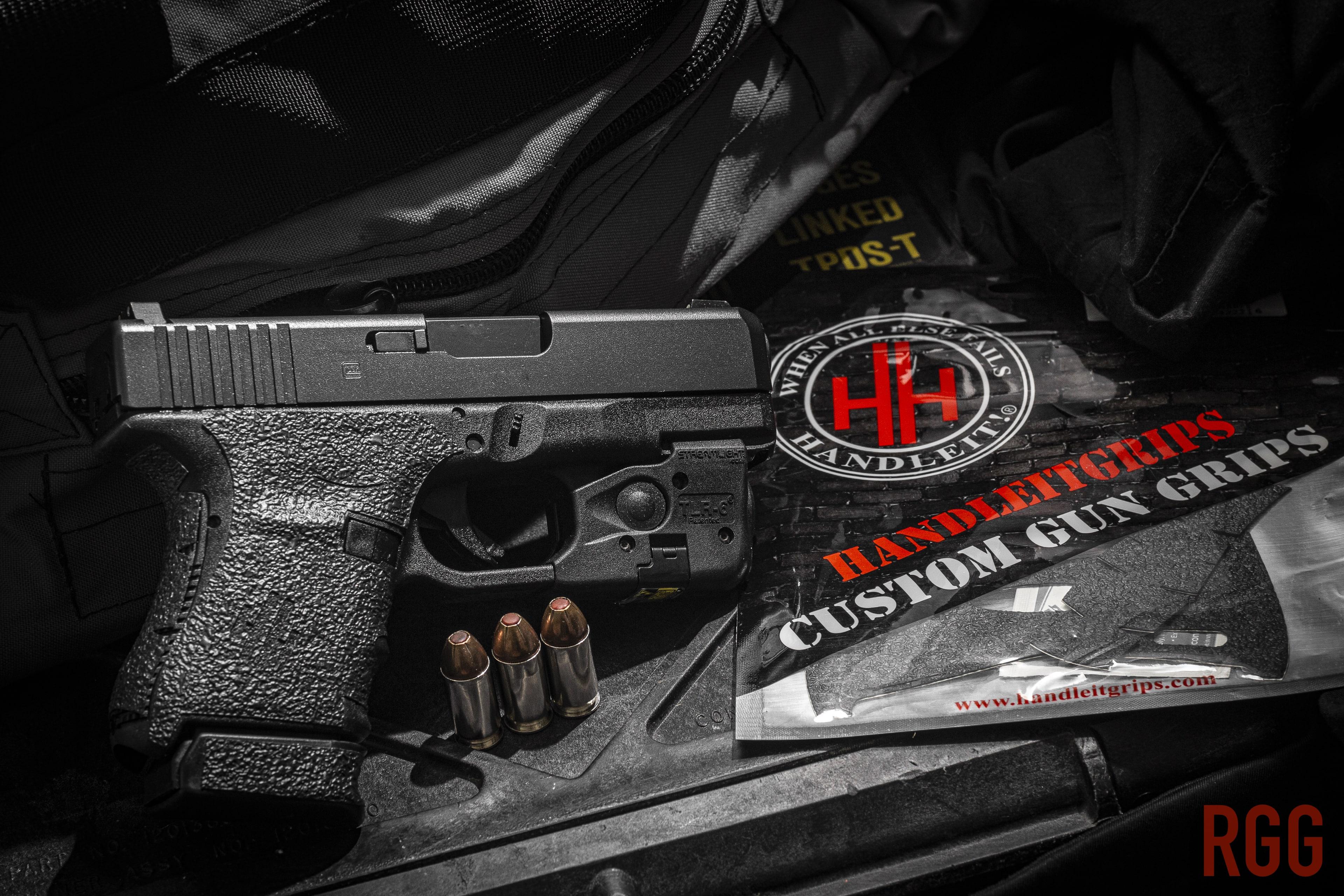 The HandleItGrips adhesive gun grip on a GLOCK 30.