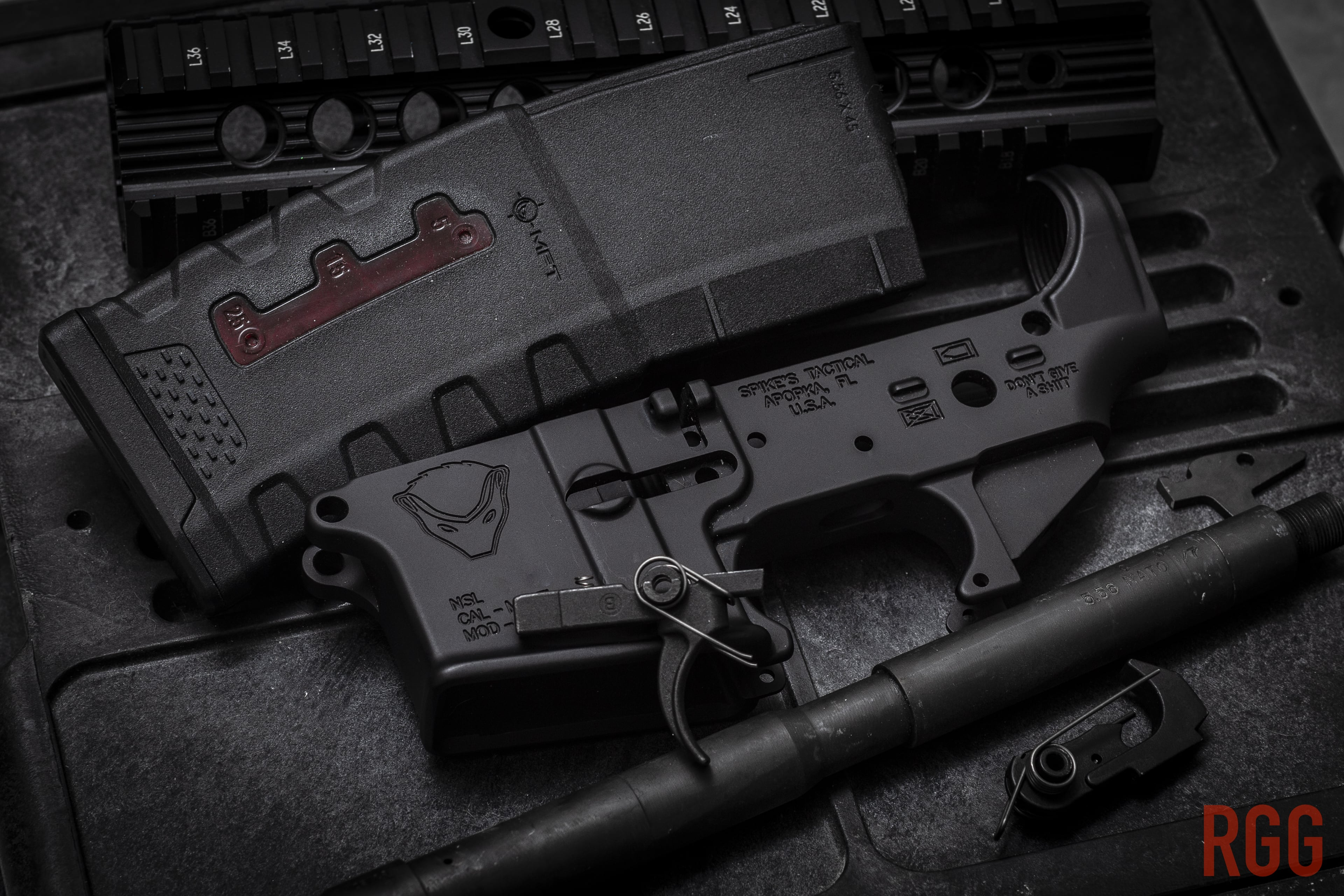 Some components that make up an AR-15 rifle.
