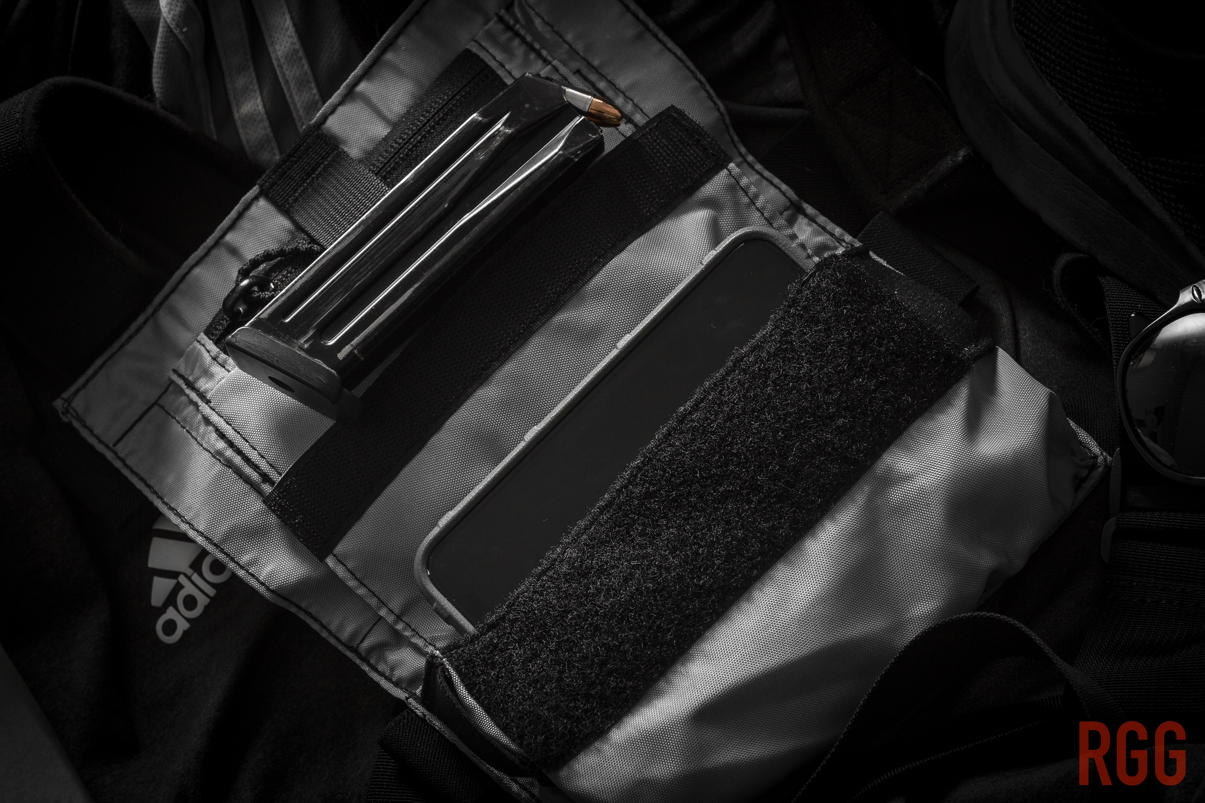 The Runner's Rig smartphone pocket can hold a smartphone, or maybe a spare magazine for your gun.