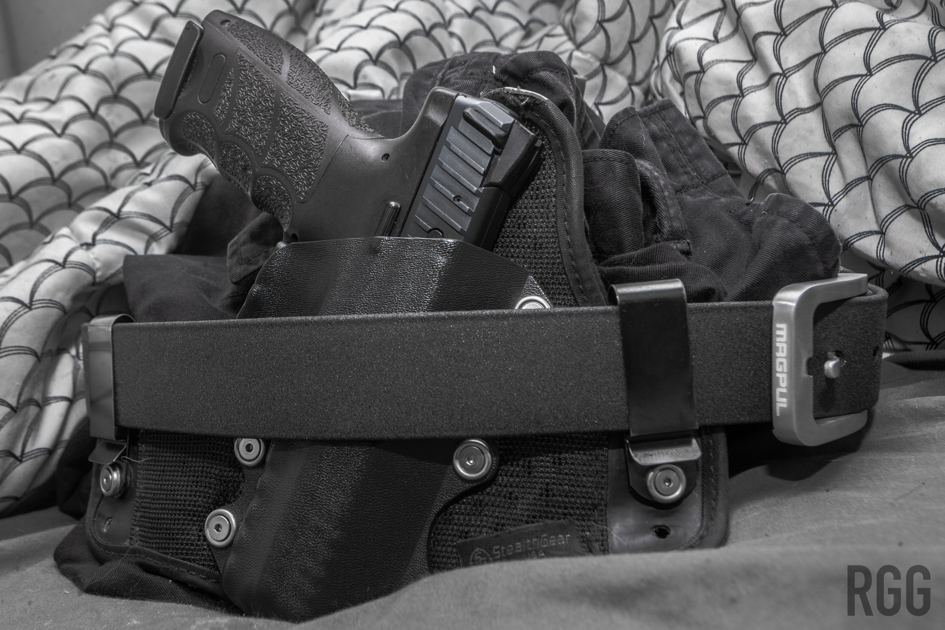 An H&K VP9 encased in a StealthGear holster attached to a Magpul Tejas El Burro Belt