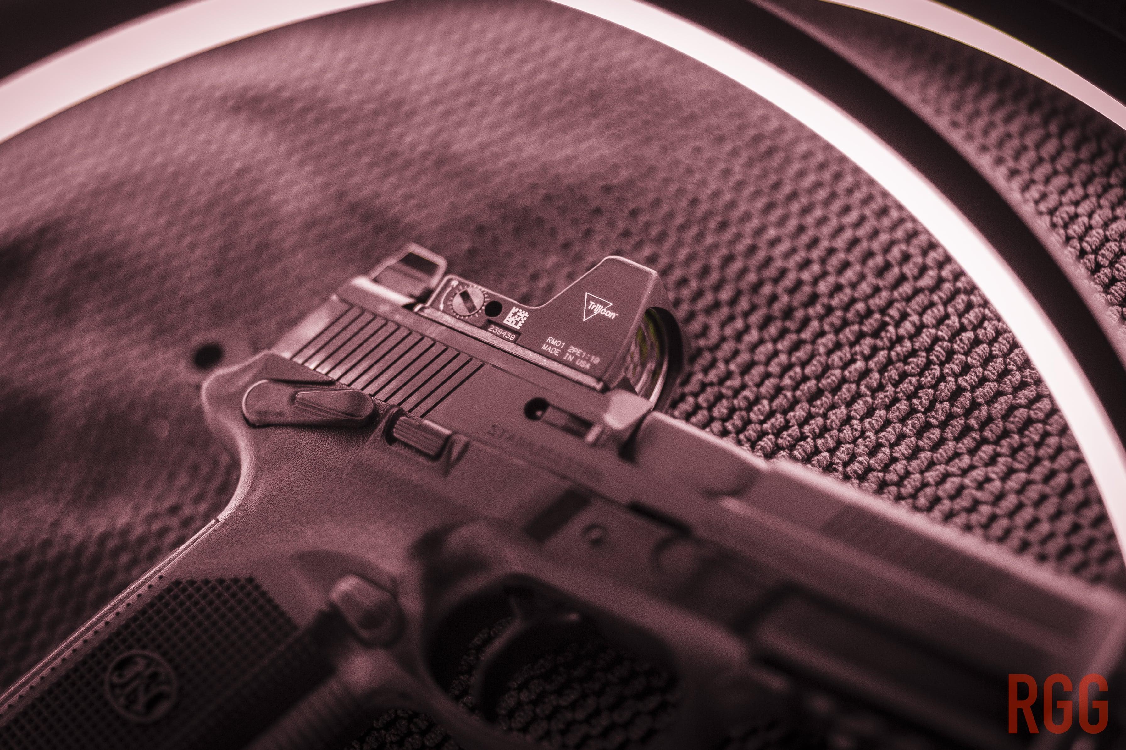 Trijicon RM01 atop an FN FNX-45 45 ACP pistol.