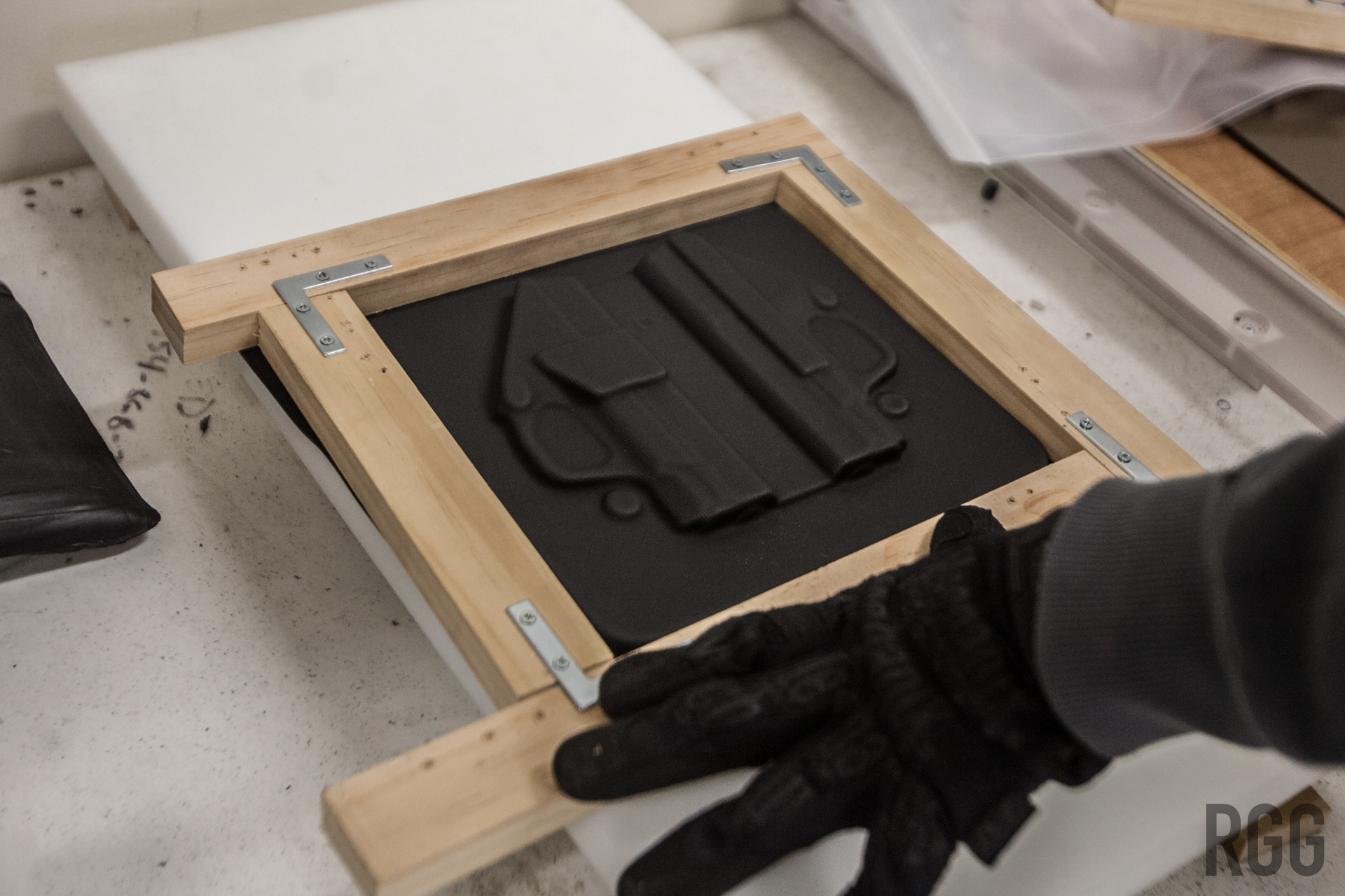 Suction conforms the heated Kydex to the holster mold...