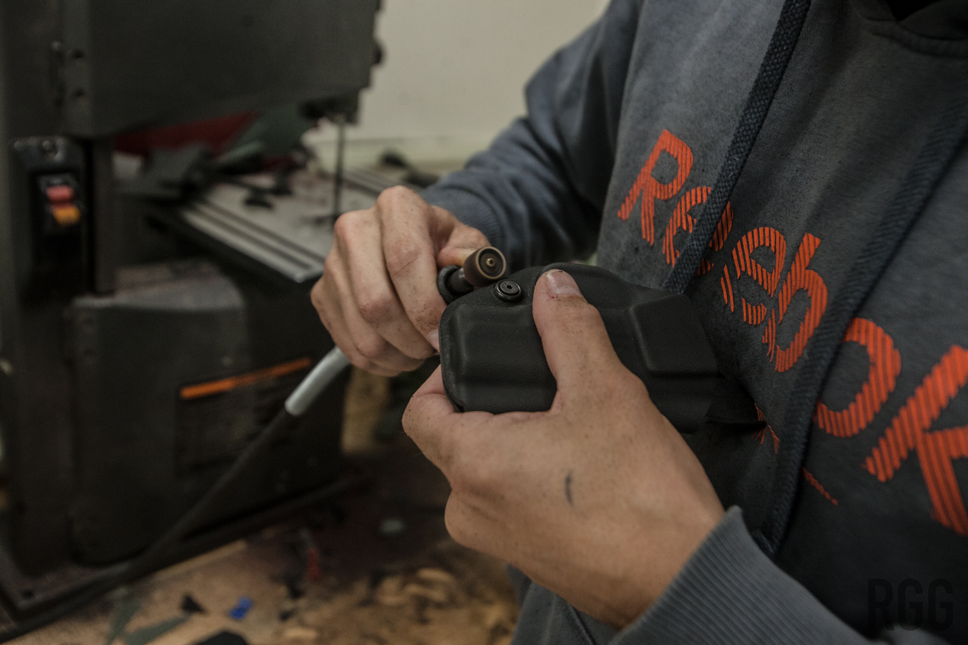 Using a rotary tool, Orion smooths out the burrs and bumps from the almost-finished product for ergonomic reasons...